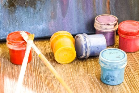 Watercolor paints, brushes on old wooden table, Watercolors Paint, Gouache, Brushes, The concept of the creative workshop of the artist