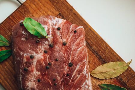 Top view of Fresh meat with bay leaf on wooden cutting board, Raw meat. Fresh beef, copy space, rump steak