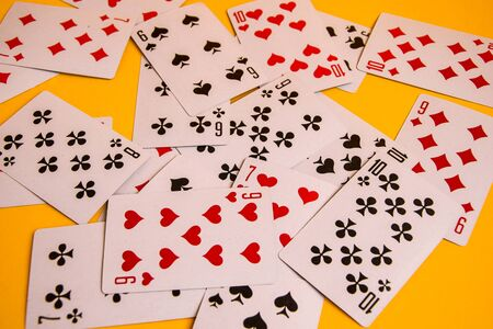 Selective focus of Playing cards on a yellow background close up, table games poker