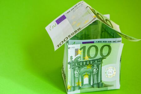100 euros, euro home on green background, House from Euro Money, money house in Europe