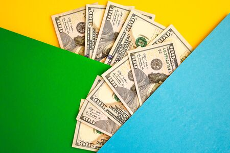 Cash Money on colorful background, Fan of 100 dollar bills on color background, copy space for you text, Save and money cocncept