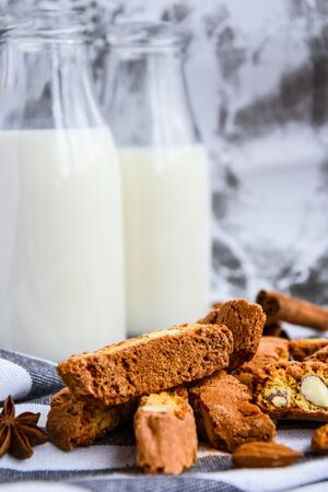 Almond milk in bottles with Cantuccini Cookie Biscuits with Almonds, cinnamon and anise, almond seeds, Healthy breakfast, Dieting Banco de Imagens