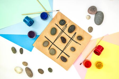 top view of tic tac toe game with stones marked with naughts and crosses. Childrens art project, a craft for children. DIY concept. Step by step photo instructions Step 5