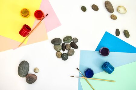top view of tic tac toe game with stones marked with naughts and crosses. Children's art project, a craft for children. DIY concept. Step by step photo instructions Step 2