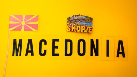 Macedonia travel concept, Magnet from Skopje and macedonian flag, passport with boarding pass