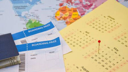 passport, boarding pass over map. travel concept., on calendar with pins Passport on map ticket, planning trip