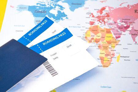 passport, boarding pass over map. travel concept., Passport on map ticket Stock Photo