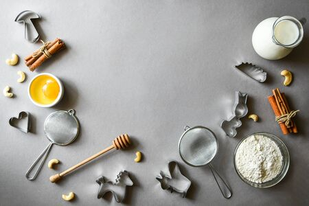 Ingredients to make pancakes or Christmas gingerbread on gray background. Copy space for text. Baking background recipe 스톡 콘텐츠