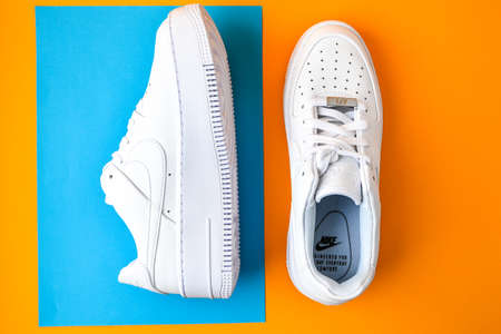 Zhytomyr, Ukraine - June 1, 2020: Nike Air Force 1 Sage white sneakers product shot on color background. Illustrative editorial photo. Sport footwear Editorial
