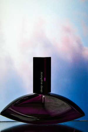 Zhytomyr, Ukraine - June 2, 2020. A bottle of Calvin Klein deep euphoria perfume, fragrance created by Calvin Klein perfume for woman on color background, Female perfume Editorial