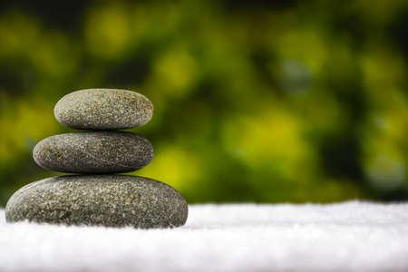 Pebbles stack, Balance, Pyramid of stones for meditation, stack of zen stones, copy space, spa treatment concept, Archivio Fotografico