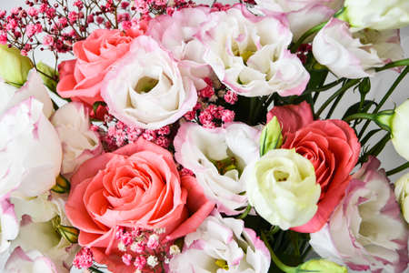 bouquet of pink and white roses and different flowers. close up, selective focus, background for Valentine's Day decoration. flower background. holiday greeting card