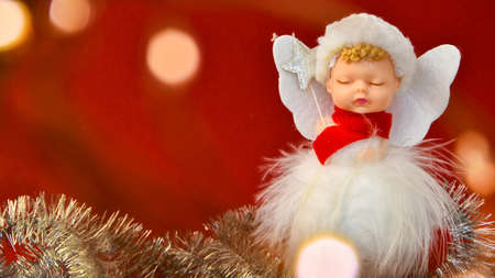 Cute Angel Christmas decoration on red background. Copy space. Greeting card. New year and merry christmas Archivio Fotografico