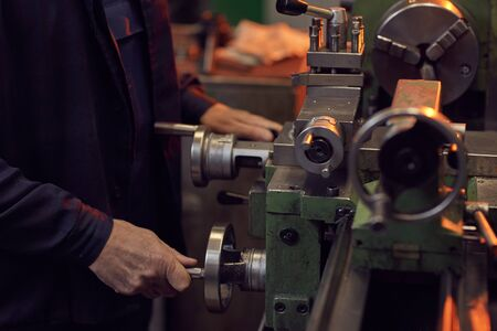 Close-up of worker working with special equipment in the factory