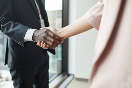 Close-up of business people standing and shaking hands they greeting each other before meeting