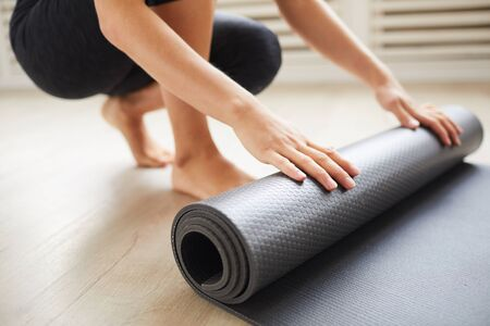 Close-up of young woman with exercise mat preparing for sports training Standard-Bild