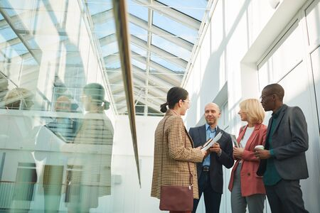Group of business people meeting each other at office building they standing and talking