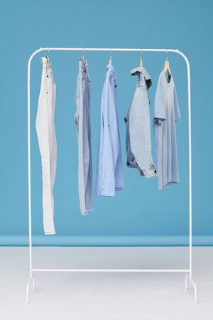 Image of jeans clothes hanging on hanger in the clothes shop