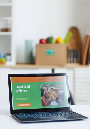 Close-up of laptop computer on the table with website of local food delivery