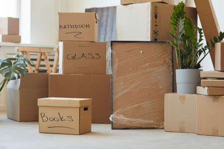 Image of heap of signed cardboard boxes in the room prepared for relocation 写真素材