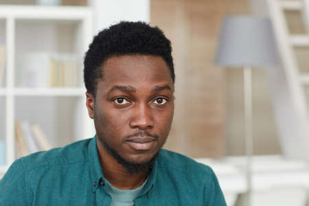 Portrait of African young man in shirt looking at camera