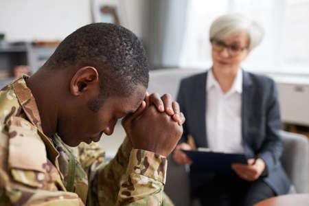 African soldier has a depression while visiting his psychologist at office