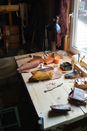 Image of workplace of shoemaker with tools on it preparing for work Stockfoto