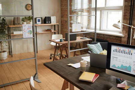 Image of empty modern office with workplace with computer on it