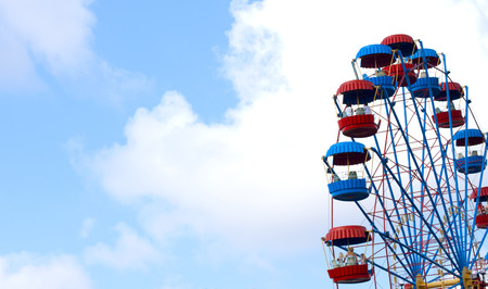 Ferris Wheel over blue sky photo