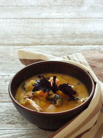 uncouth: Soup with salmon and mussels in clay pot Stock Photo