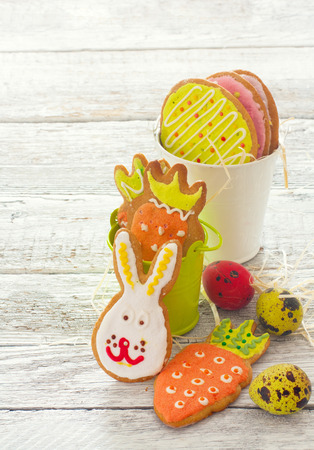 Funny Easter cookies and eggs over wood white