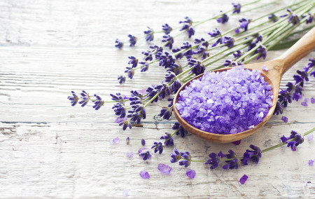 Spa background with lavender  flowers and spoon of sea salt