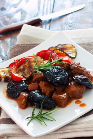 stewed: Beef stewed with prunes and vegetables