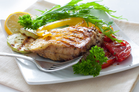white fish: Grilled portion of flounder with vegetables