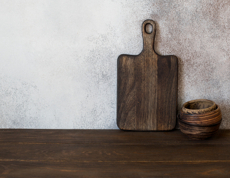Food background with wooden cutting board and set of bowls