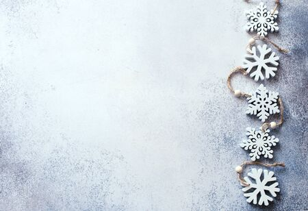 Christmas and New Year blue stone background with decorative snowflakes. Flat lay. Copy space Banque d'images