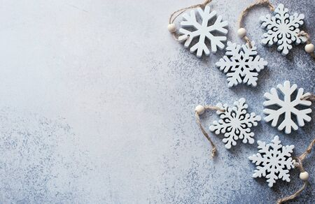 Christmas and New Year gray stonebackground with decorative snowflakes. Flat lay. Copy space