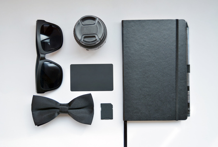 notebook: Business workplace with  glasses, tie, business card, memory card and notebook on white background