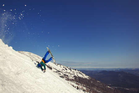 Snowboarder falling down in snow mountain