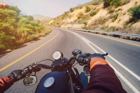 The Road view over the handlebars of motorcycle Фото со стока