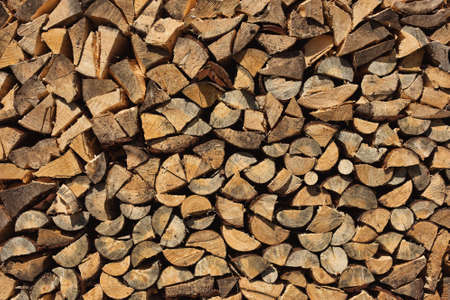 Chopped Firewood in Village. Background