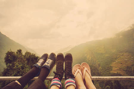 Friends legs outdoor on mountain background. Travel together Фото со стока