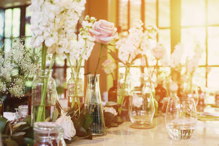 Luxury flower decoration on wedding table. Romantic party in Restaurant