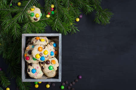 Christmas card. Space for text. Christmas tree on a black wooden background with sweets and biscuits. The original idea of ??Christmas. New Year. top view blank space for text Christmas. Copy Space.