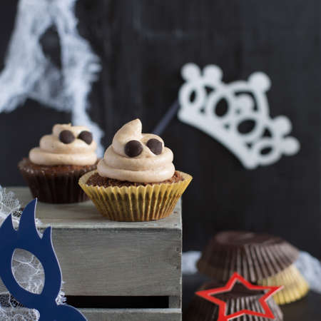 Halloween. Halloween dessert. Dessert for a childrens holiday. Chocolate cupcakes. Cupcakes like a ghost. Food for Halloween. Funny idea for Halloween