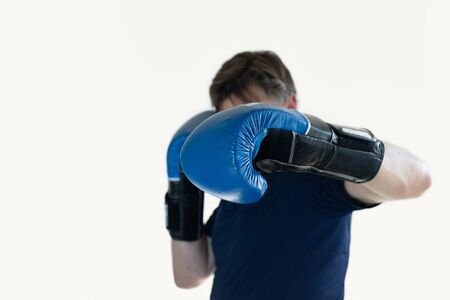 a man with blue Boxing gloves lands a left hook