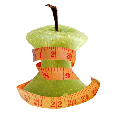 centimetre: on a white background a green apple and centimetre ribbon is located Stock Photo