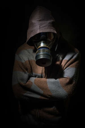 damnation: Man in gasmask against dark background
