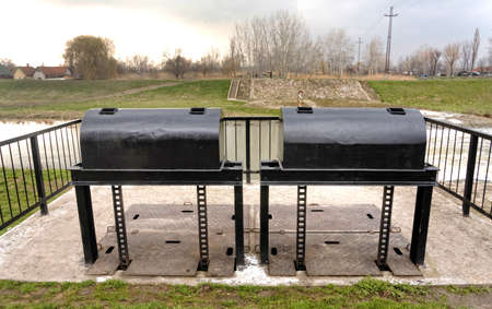 sluice: Water regulatory system close up Stock Photo