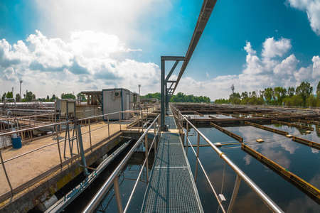 facilities: Water treatment facility with large pools of water Stock Photo